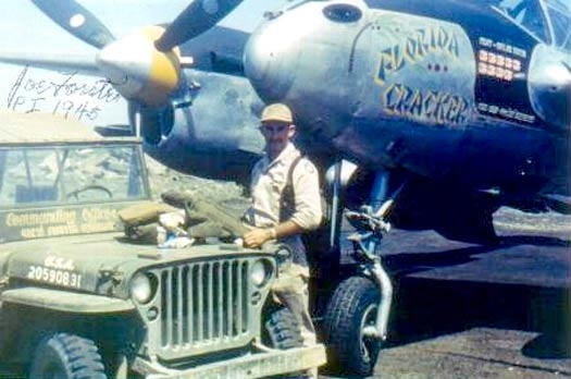 """Captain Forster with his P-38 """"Florida Cracker"""", Philippine Islands 1945."""